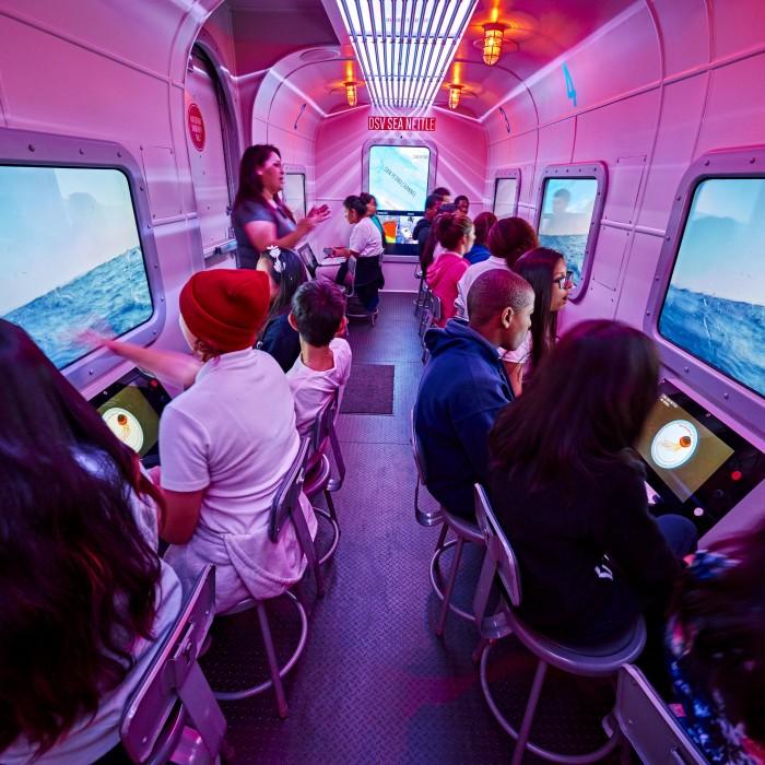 mobile museum ocean experience kids in bus NHM programs