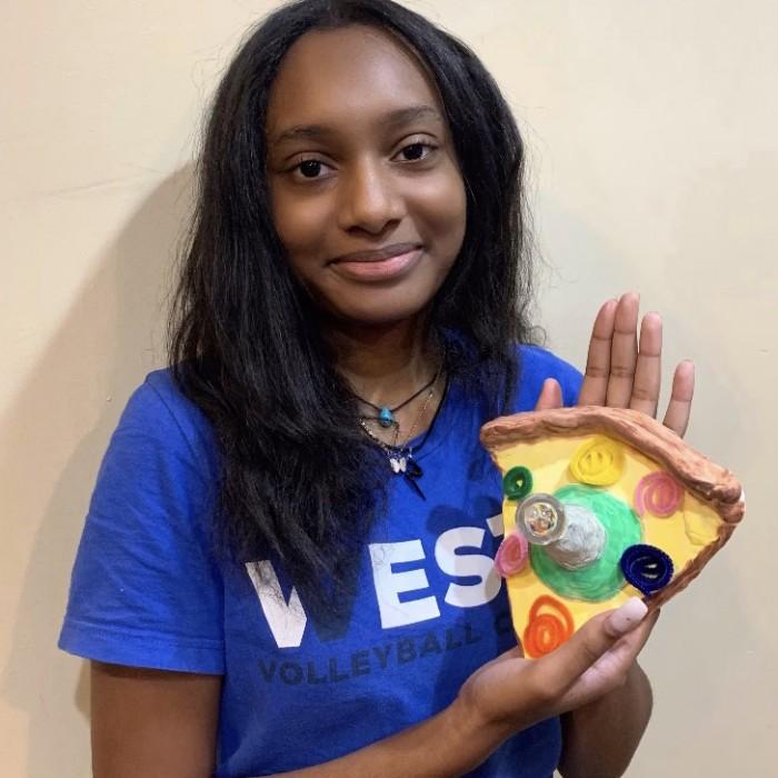 Kiana holding her finished product