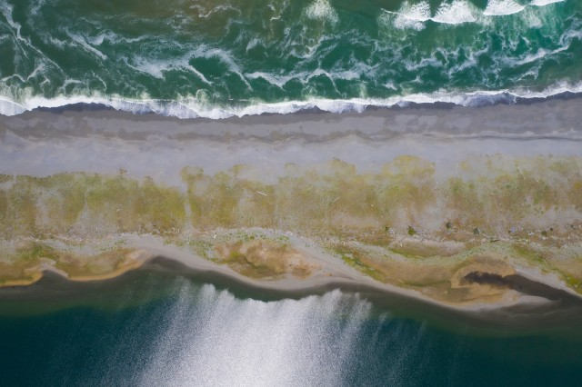 aerial view of waves on a beach