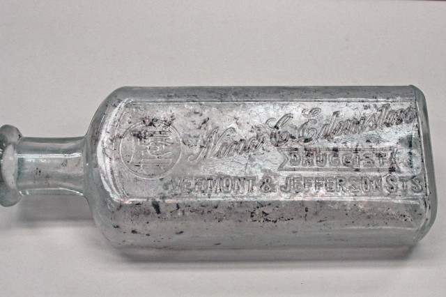 Clear glass drug bottle from turn of the century