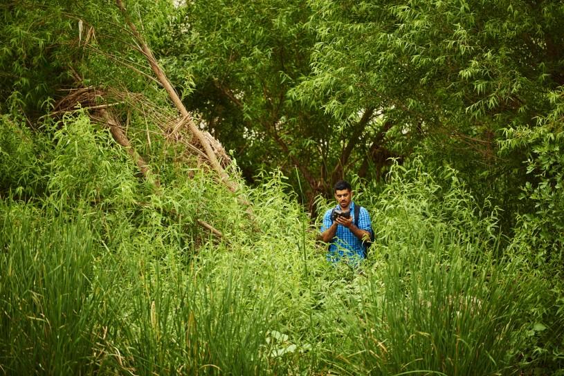 Miguel Ordeñana using motion-sensing camera traps along the river