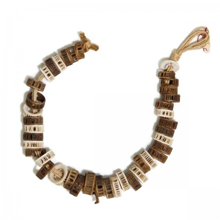 Beads from the Channel Islands made from fish vertebrae, above, and steatite and clamshell beads,